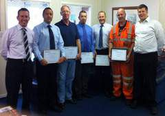 Staff  receivng long service awards